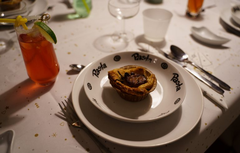 Chicken pie on decorated dinner table